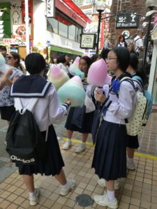 School girls eating Candy Floss