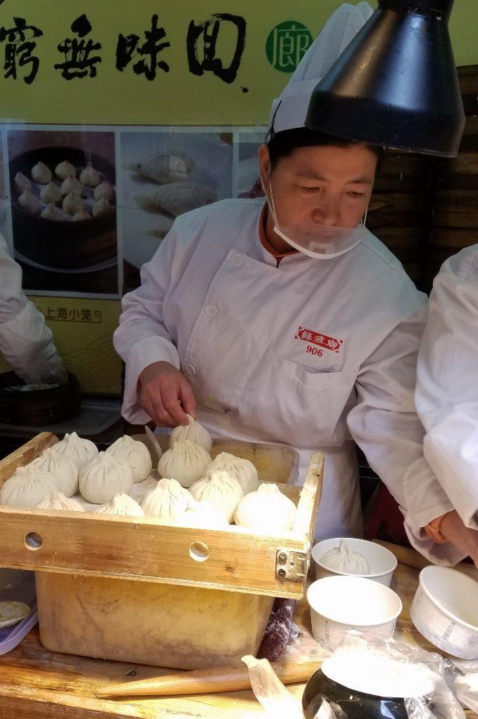 Soup dumplings being made